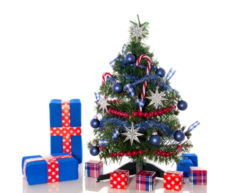 a red white blue dcorated christmas tree with gifts isolated over white