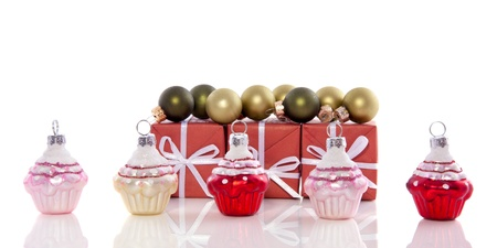 cheerful cupcake christmas balls with gifts isolated over white photo