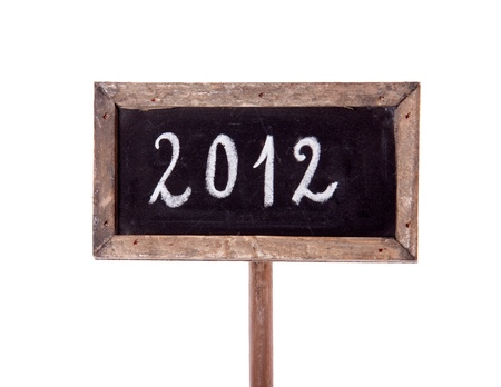 new year 2012 written on a blackboard with wooden frame with chalk isolated over white background photo