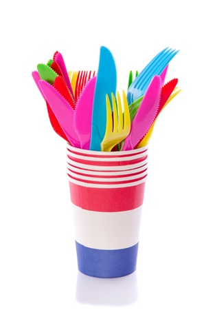 colorful plastic cutlery in stacked cups isolated over white Stock Photo