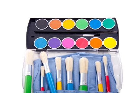 colorful water color paint with a set of paint brushes isolated over white Stock Photo