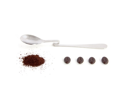spoon with filter coffee and beans isolated over white photo