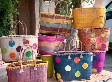 colorful handmade shopping bags for sale on a market