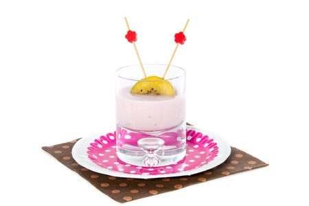 nicely decorated kiwi fruit with yoghurt isolated on white background