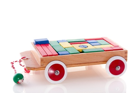 a toy car with wooden colored blocks isolated over white