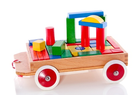 colorful wooden toy bocks in a car isolated over white Stock Photo