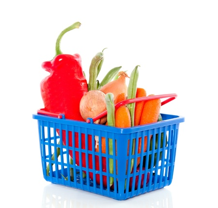 fresh vegetables in a plastic shopping basket isolated over white Stock Photo