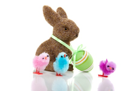 bunnie: a brown bunnie with an easter egg on his neck and three little colored chicks isolated over white Stock Photo