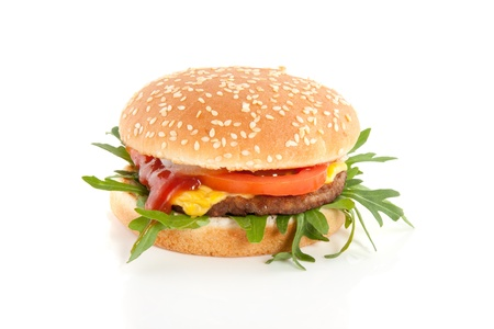 a close up of a fresh hamburger with cheese and salad and tomato   isolated over white