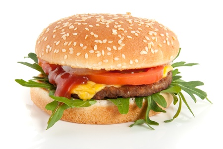 a fresh hamburger with cheese and salad isolated over white