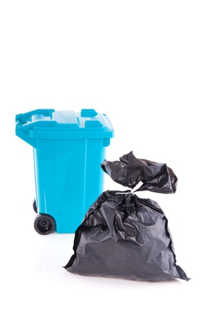 a blue wheelie bin and a grey garbage bag isolated over white