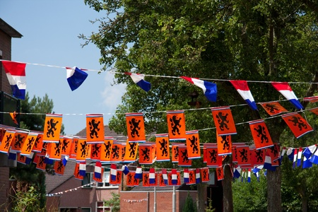 neighborhood arts for Dutch celebration for football or Queens day against a blue sky