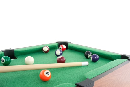 a game of pool billiard on a green pool table isolated over white