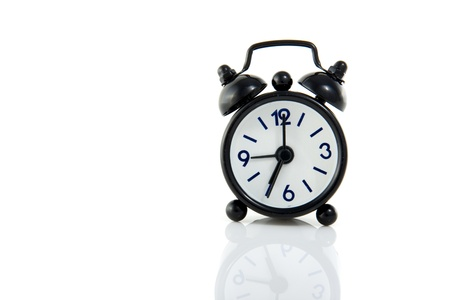 a little black alarm clock isolated over white Stock Photo
