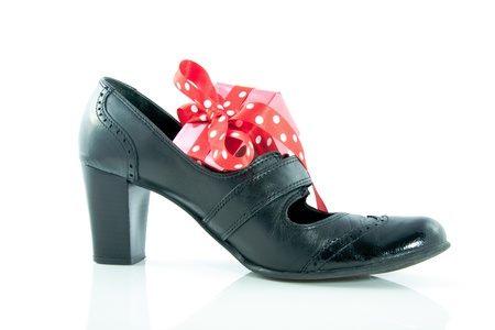 Gift in a shoe isolated over white