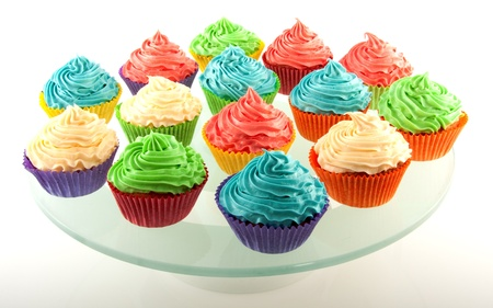 fresh made iced cupcakes isolated on white background