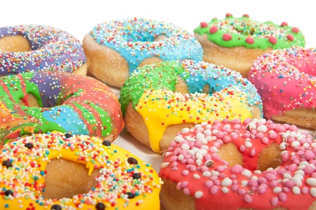 a group of colorful glazed donuts with speckles on top Stock Photo