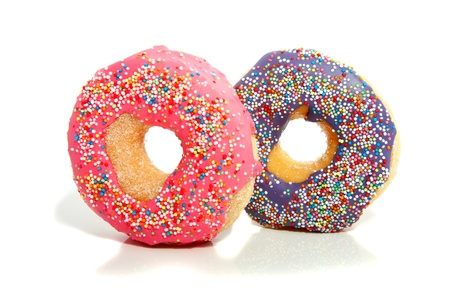 two iced donuts with speckles on top
