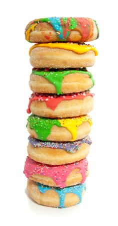 eight colorful vertical donuts with speckles on top