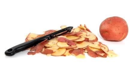 red potatoe peel and a black potatoe peeler isolated over white
