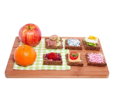 Healthy varied lunch with slices bread and fruit isolated white background photo