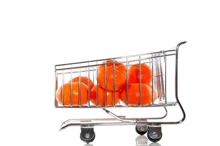 necessity: mandarins in a shopping cart fruit on white background Stock Photo