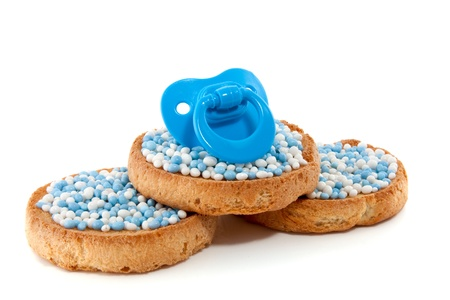baby pacifier on top of Dutch Birth biscuits Stock Photo