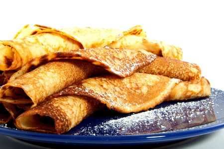 flapjacks: many baked rolled Dutch pancakes on a blue dish