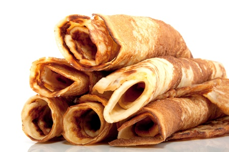many rolled pancakes isolated over white background Stock Photo