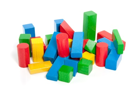 colorful wooden play blocks isolated over white