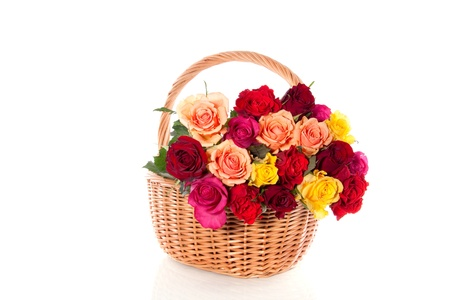 four colored roses in a basket