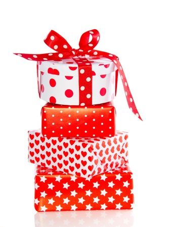 red and white gifts for any celebration isolated over white photo