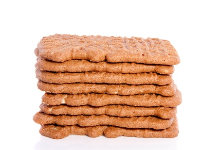 a stack of Dutch spiced Speculaas cookies isolated on white background photo