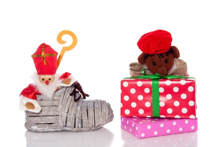 Dutch Sinterklaas celebration with gifts and a hoe with Sint en Piet isolated on white background photo
