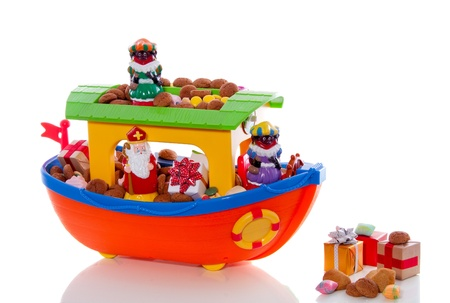 Dutch festive with Sinterklaas and Piet on the boat isolated on white background photo