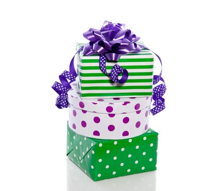 green and purple gifts for any celebration isolated over white Stock Photo