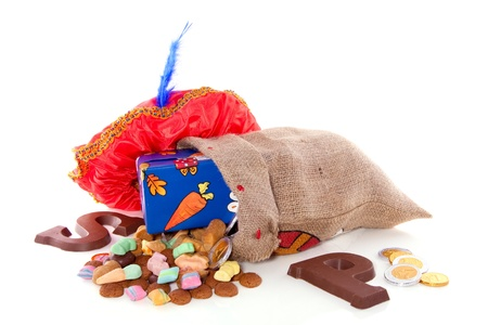 santa s bag: Dutch Sinterklaas celebration with chocolate and  gingernuts and presents isolated on white background