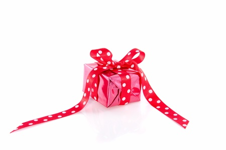 red gift with a dotted ribbon isolated over white