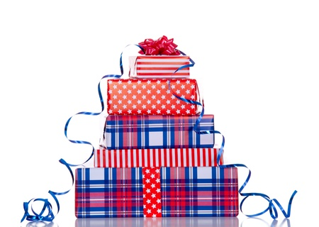 a stack of red white blue gifts with ribbon and bow isolated over white