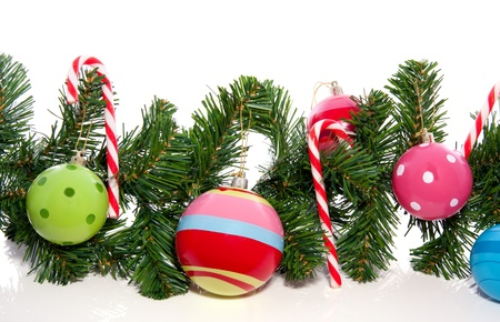 candy cane and christmas balls isolated on white background