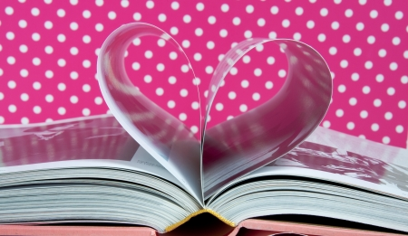 a heart formed with the pages of a book