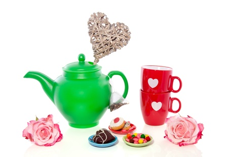 a lovely valentine high-tea setting with cookies and candy isolated over white Stock Photo