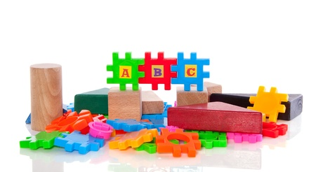 educational colorful plastic and wooden puzzle toy blocks isolated over white