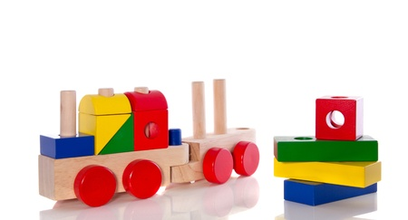 stacked wooden toy blocks and an educative wooden train isolated over white Stock Photo