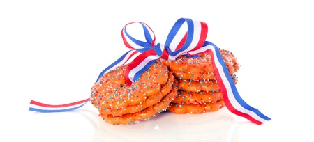 stacked Dutch Queensday cookies with a ribbon isolated on white background