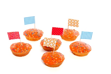 Queensday cake with flags and speckles isolated on white background