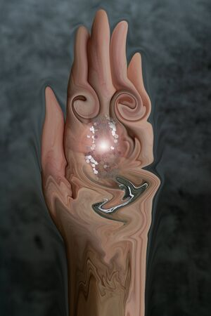 An abstract art of hand holding a melting glitter on a gray marble background Фото со стока