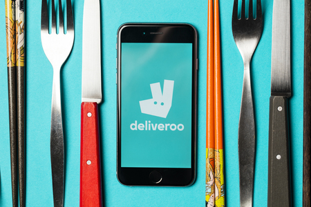 LONDON, UK - NOVEMBER 9th 2017: An apple iPhone showing the Deliveroo application logo. Deliveroo is an online takeaway delivery service