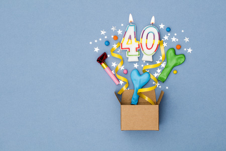 Number 40 celebration present background. Gift box exploding with party decorations