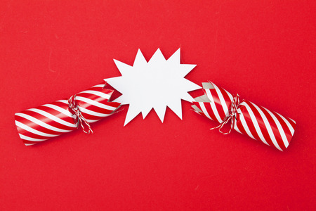 Popped Christmas crackers on a red background